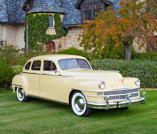 AUT 20 RK0689 01 © Kimball Stock 1947 Chrysler New Yorker Cream 3/4 Front View On Grass By House