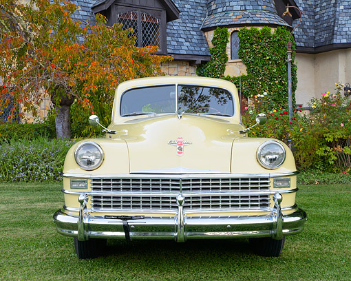 AUT 20 RK0690 01 © Kimball Stock 1947 Chrysler New Yorker Cream Front View On Grass By House