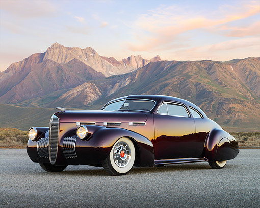 AUT 20 RK0698 01 © Kimball Stock 1940 Cadillac La Salle Candy Brandywine 3/4 Side View On Pavement By Mountains At Dusk