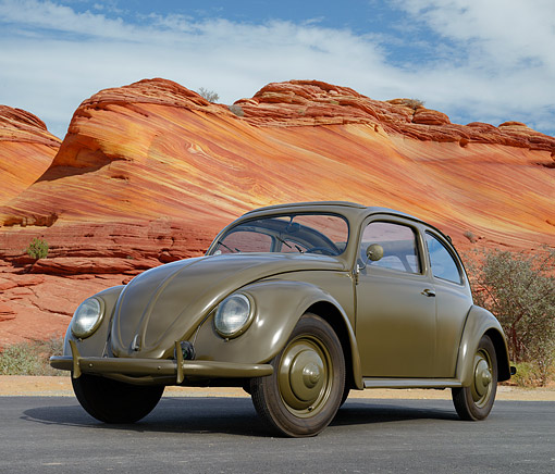 AUT 20 RK0700 01 © Kimball Stock 1946 Volkswagen Beetle Green 3/4 Front View On Pavement By Red Rock