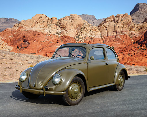 AUT 20 RK0701 01 © Kimball Stock 1946 Volkswagen Beetle Green 3/4 Front View On Pavement By Red Rock