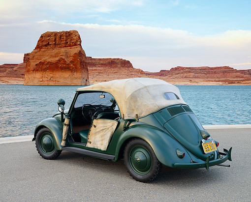AUT 20 RK0704 01 © Kimball Stock 1949 Volkswagen Hebmuller Police Car Green 3/4 Rear View On Pavement By Water And Red Rock
