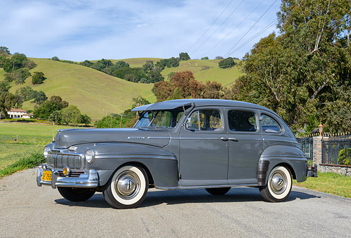 AUT 20 RK0705 01 © Kimball Stock 1947 Mercury Town Sedan Gunmetal Gray 3/4 Side View On Pavement By Grassy Hills