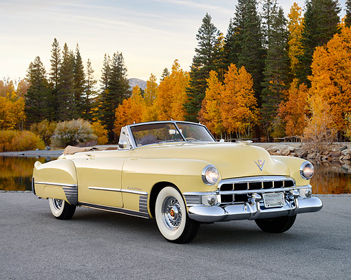 AUT 20 RK0710 01 © Kimball Stock 1949 Cadillac Series 62 Convertible Coupe Yellow 3/4 Front View On Pavement By Water