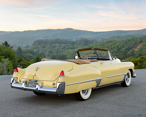 AUT 20 RK0713 01 © Kimball Stock 1949 Cadillac Series 62 Convertible Coupe Yellow 3/4 Rear View On Pavement