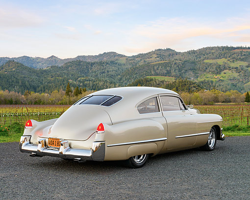AUT 20 RK0717 01 © Kimball Stock 1949 Cadillac 61 Sedanette Champaign Pearl 3/4 Rear View On Pavement By Vineyard