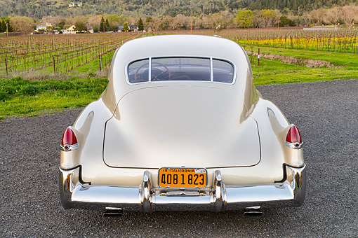 AUT 20 RK0718 01 © Kimball Stock 1949 Cadillac 61 Sedanette Champaign Pearl 3/4 Rear View On Pavement By Vineyard