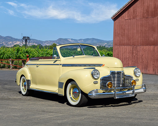 AUT 20 RK0719 01 © Kimball Stock 1941 Chevrolet Deluxe Convertible Butternut Yellow On Open Vineyard