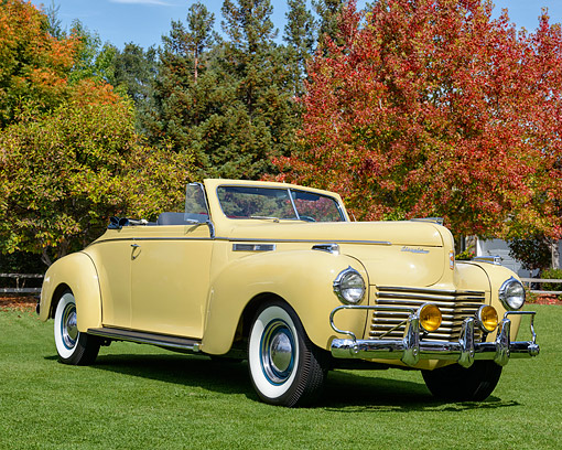 AUT 20 RK0721 01 © Kimball Stock 1940 Chrysler New Yorker Convertible Yellow 3/4 Front View In Autumn Scene