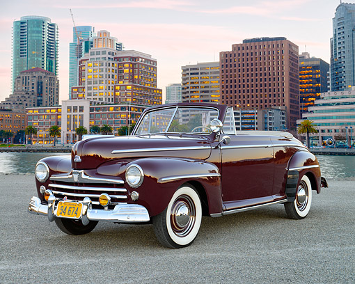 AUT 20 RK0724 01 © Kimball Stock 1947 Ford Super Deluxe Coupe Pheasant Red 3/4 Front View In City