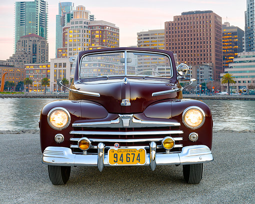AUT 20 RK0725 01 © Kimball Stock 1947 Ford Super Deluxe Coupe Pheasant Red Front View In City