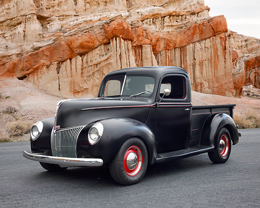 AUT 20 RK0727 01 © Kimball Stock 1941 Ford Pickup Black 3/4 Front View In Desert
