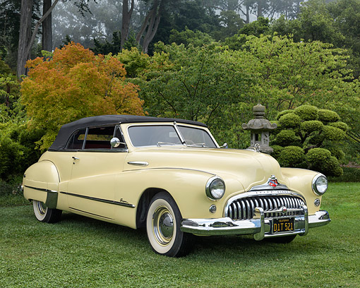 AUT 20 RK0730 01 © Kimball Stock 1948 Buick Super Yellow 3/4 Front View On Grass By Trees