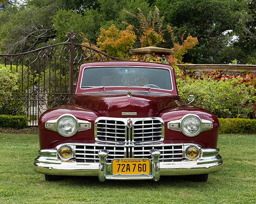 AUT 20 RK0731 01 © Kimball Stock 1948 Lincoln Continental Coupe Maroon Front View On Grass