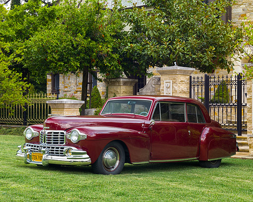 AUT 20 RK0732 01 © Kimball Stock 1948 Lincoln Continental Coupe Maroon 3/4 Front View On Grass By Mansion