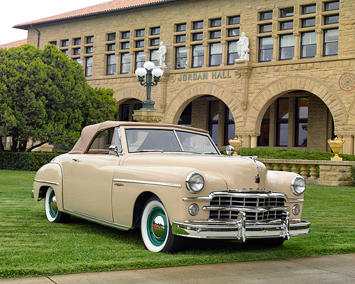 AUT 20 RK0733 01 © Kimball Stock 1949 Dodge Wayfarer Roadster Beige 3/4 Front View By University Building