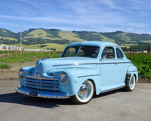 AUT 20 RK0735 01 © Kimball Stock 1946 Ford Coupe Super Deluxe Blue 3/4 Front View By Farm