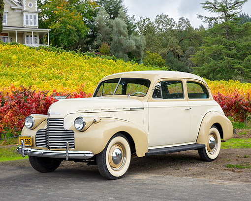 AUT 20 RK0736 01 © Kimball Stock 1940 Chevrolet Master Deluxe Tan 3/4 Front View By Vineyard And House