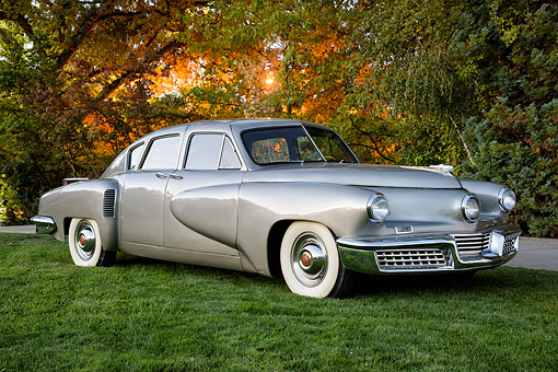 AUT 20 RK0745 01 © Kimball Stock 1948 Tucker 48 Torpedo Silver 3/4 Front View By Trees