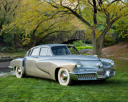 AUT 20 RK0746 01 © Kimball Stock 1948 Tucker 48 Torpedo Silver 3/4 Front View By Trees And Creek