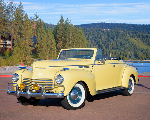 AUT 20 RK0753 01 © Kimball Stock 1940 Chrysler New Yorker Convertible Yellow 3/4 Front View By Lake