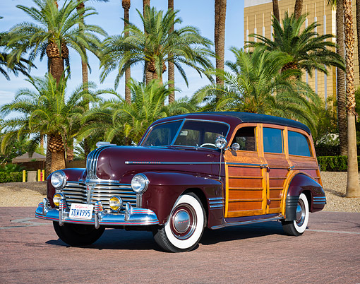 AUT 20 RK0754 01 © Kimball Stock 1941 Pontiac Woodie Wagon Maroon 3/4 Front View By Palm Trees
