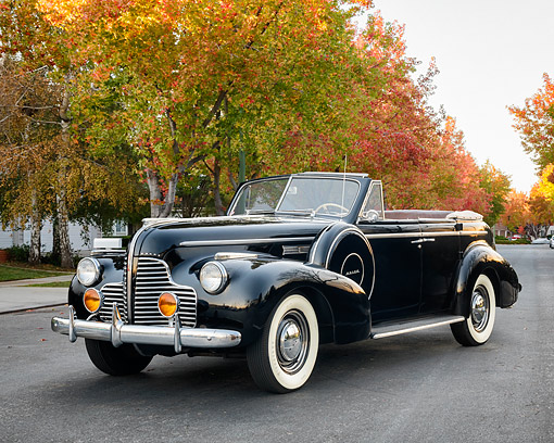 AUT 20 RK0758 01 © Kimball Stock 1940 Buick Special Eight Convertible Black 3/4 Front View By Autumn Trees