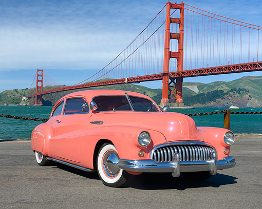 AUT 20 RK0759 01 © Kimball Stock 1948 Buick Super 2-Door Sedanette Salmon Pink 3/4 Front View By Golden Gate Bridge