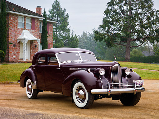 AUT 20 RK0760 01 © Kimball Stock 1940 Packard Darrin Sport Sedan Burgundy Front 3/4 View By Mansion