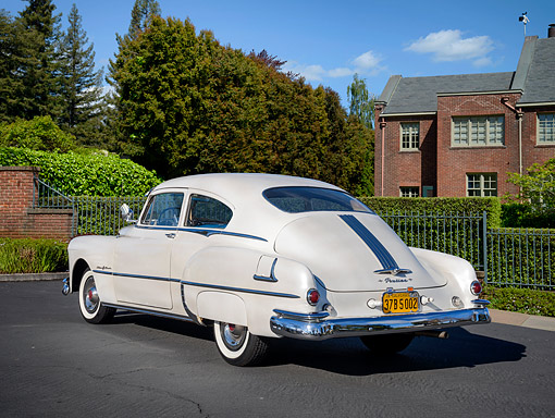 AUT 20 RK0762 01 © Kimball Stock 1949 Pontiac Silver Streak Steamliner Deluxe White 3/4 Rear View By Mansion And Trees