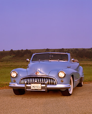AUT 20 RK0021 02 © Kimball Stock 1946 Buick Super Convertible Light Blue 3/4 Front View On Pavement At Dusk