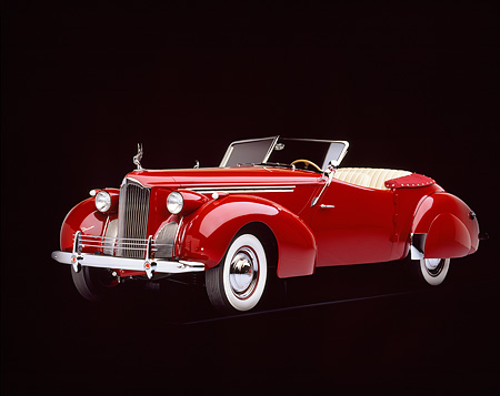 AUT 20 RK0026 04 © Kimball Stock 1940 Packard Darrin Body Convertible Burgundy 3/4 Front View Studio