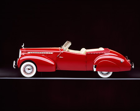 AUT 20 RK0027 02 © Kimball Stock 1940 Packard Darrin Body Convertible Burgundy Profile View On Gray Line Studio