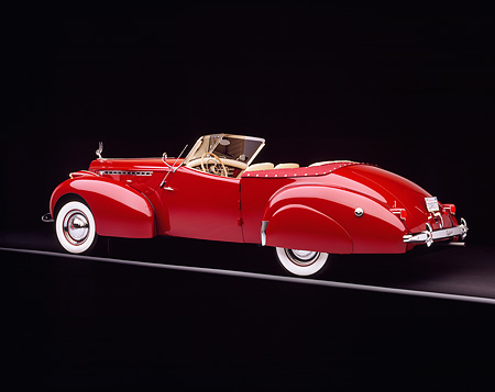 AUT 20 RK0028 02 © Kimball Stock 1940 Packard Darrin Body Convertible 3/4 Rear View Studio