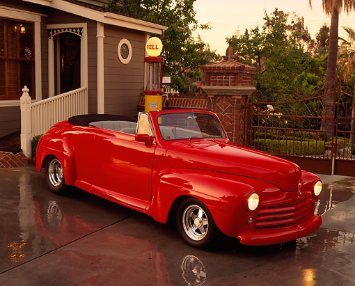 AUT 20 RK0046 03 © Kimball Stock 1947 Ford Convertible Red 3/4 Front View On Pavement