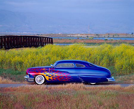 AUT 20 RK0061 01 © Kimball Stock 1949 Mercury Custom Street Rod Blue With Flames Profile By Bushes