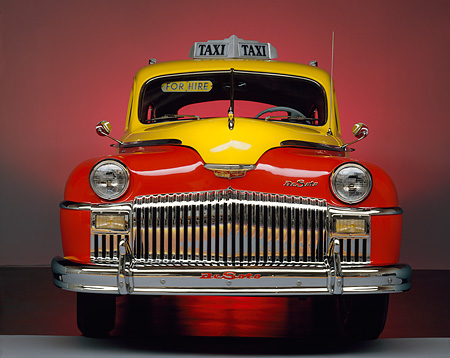 AUT 20 RK0067 02 © Kimball Stock 1946 De Soto Taxi Cab Red And Yellow Head On Shot Red Lighting Background