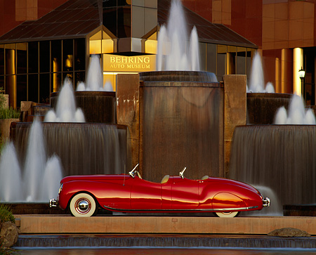 AUT 20 RK0070 13 © Kimball Stock 1941 Chrysler Newport Convertible Red Profile By Water Fountains