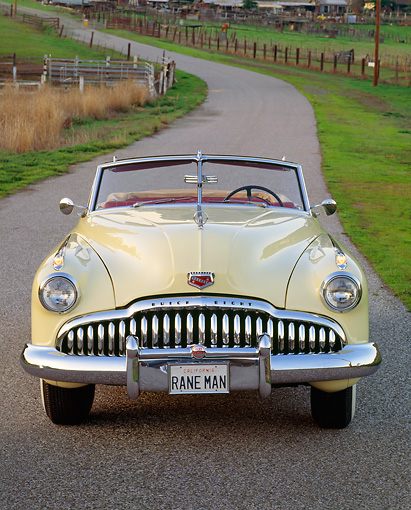 AUT 20 RK0084 02 © Kimball Stock 1949 Buick Roadmaster Convertible Yellow Head On Shot On Pavement
