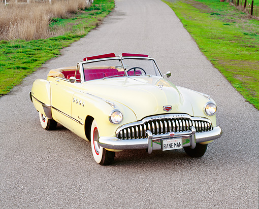 AUT 20 RK0086 01 © Kimball Stock 1949 Buick Roadmaster Convertible Yellow 3/4 Front View On Road