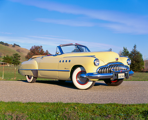 AUT 20 RK0088 01 © Kimball Stock 1949 Buick Roadmaster Convertible Yellow 3/4 On Road