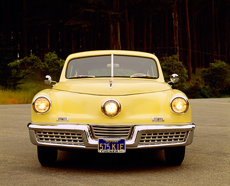 AUT 20 RK0098 12 © Kimball Stock 1948 Tucker Torpedo Yellow Head On View By Trees