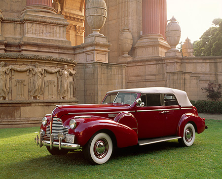 AUT 20 RK0113 02 © Kimball Stock 1940 Buick 81C Convertible Sedan Burgundy 3/4 Front View By Palace Of Fine Arts San Francisco