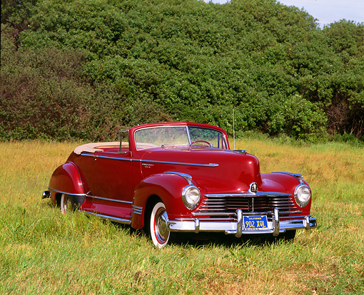AUT 20 RK0114 02 © Kimball Stock 1946 Hudson Super 6 Convertible Red 3/4 Front View On Grass