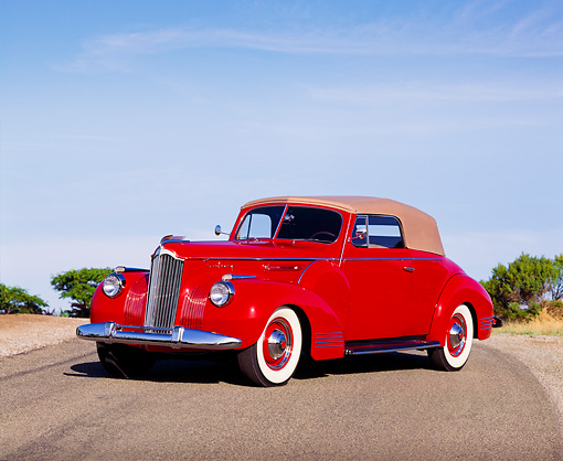 AUT 20 RK0117 10 © Kimball Stock 1941 Red Packard 160 Deluxe Convertible 3/4 Front View On Road