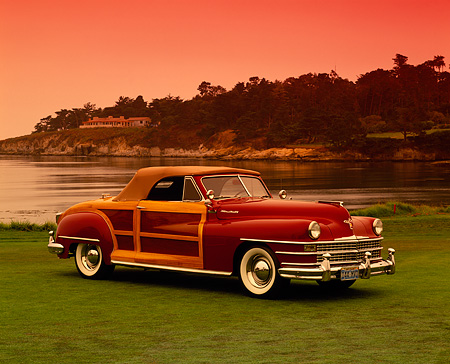 AUT 20 RK0175 04 © Kimball Stock 1946 Chrysler Town & Country Burgundy 3/4 Side View On Grass By Water Pebble Beach