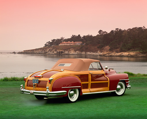 AUT 20 RK0176 03 © Kimball Stock 1946 Chrysler Town & Country Burgundy 3/4 Rear View On Grass By Water Pebble Beach