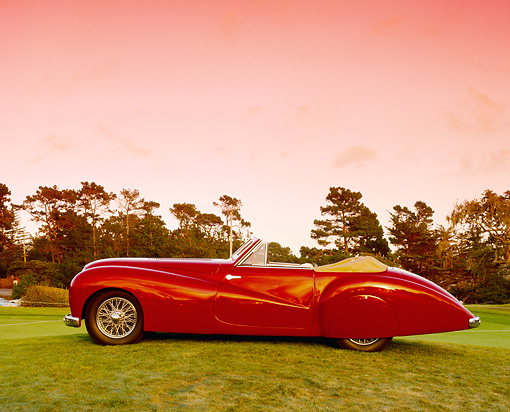 AUT 20 RK0194 01 © Kimball Stock 1948 Delahaye 135 M Pourtout Cabriolet Red Profile View On Grass Filtered