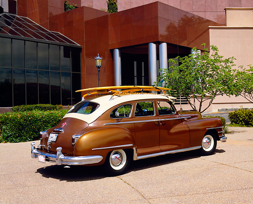 AUT 20 RK0237 01 © Kimball Stock 1948 Chrysler Traveler Bronze 3/4 Rear View On Pavement By Museum