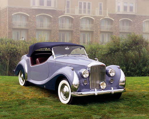 AUT 20 RK0248 02 © Kimball Stock 1948 Bentley Convertible Periwinkle 3/4 Front View On Grass In Fog